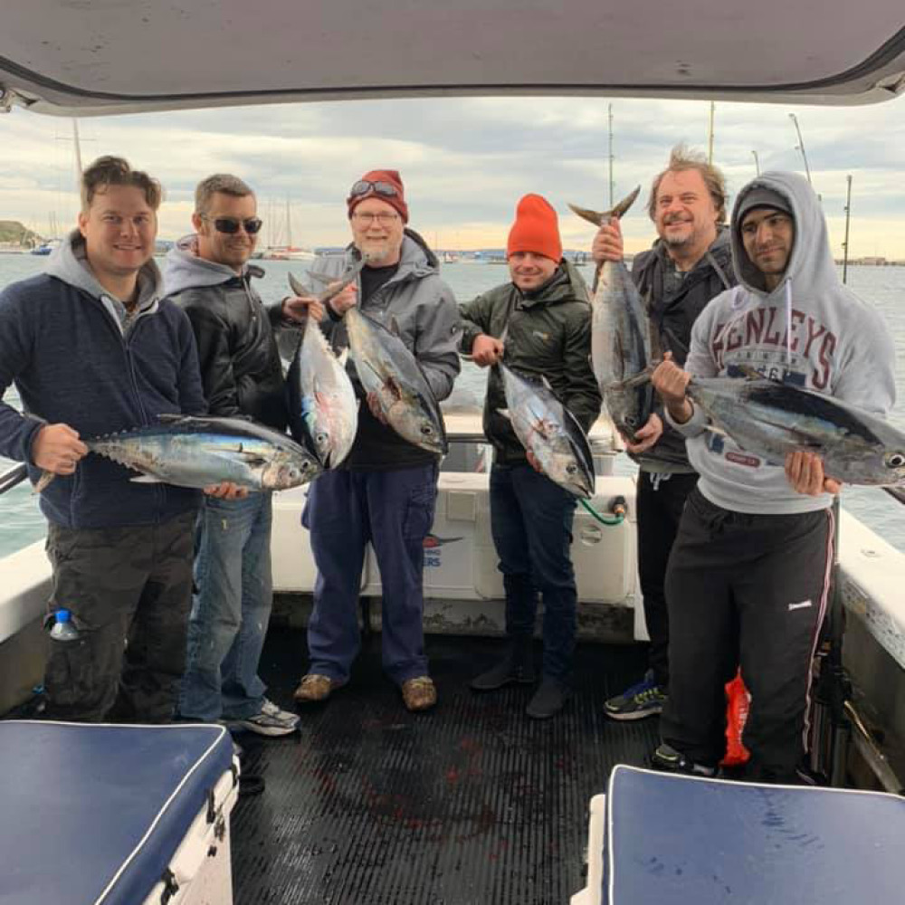 happy group of bagout tuna fishing charter customers