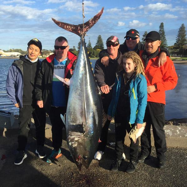 family of happy bagout tuna fishing charter customers