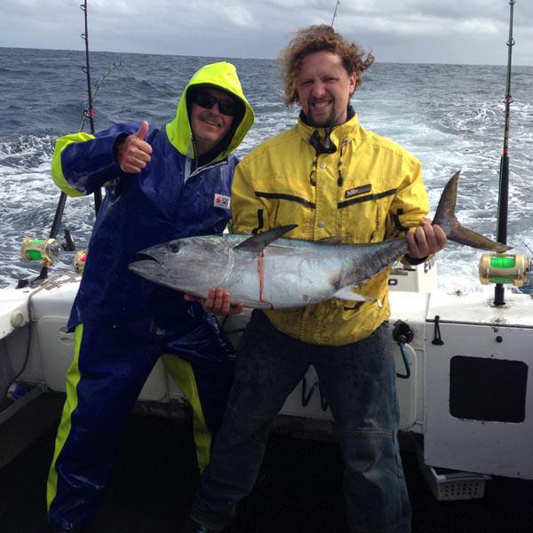 two happy bagout tuna fishing charter customers
