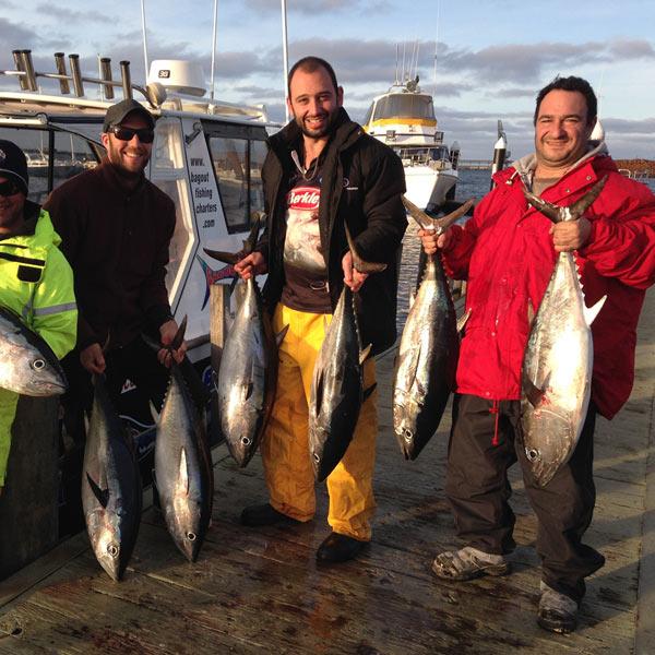 three happy bagout tuna fishing charter customers