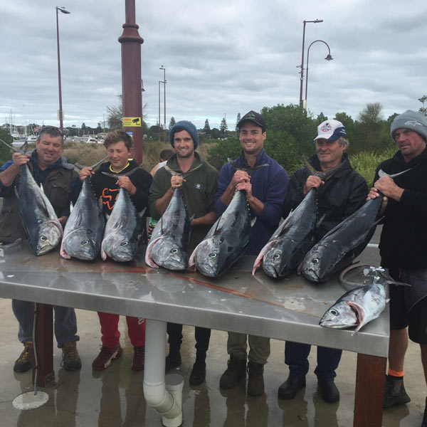 large group of happy bagout tuna fishing charter customers